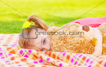 Little girl with soft toy