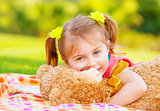 Little girl hugging soft toy