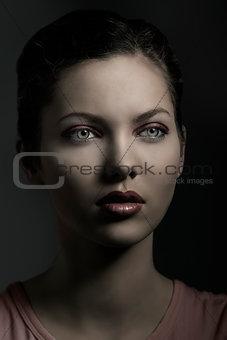 beautiful woman in dark portrait