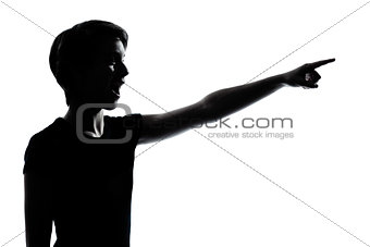 one young teenager boy or girl pointing surprised silhouette