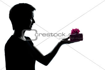 one young teenager girl offering present gift silhouette