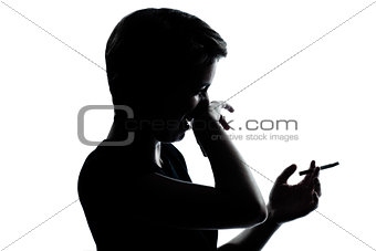 one young teenager boy or girl smoking cigarette disgust silhoue