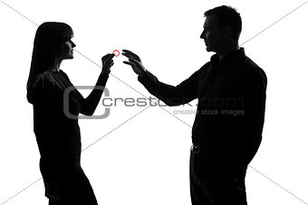 one couple man and woman holding giving condom