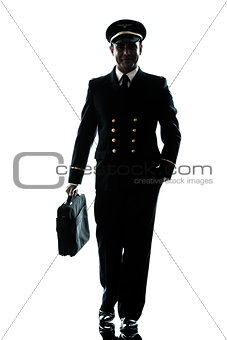 man in airline pilot uniform silhouette walking