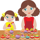 Mother with the daughter bake cupcakes