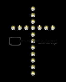 Cross laid out candles