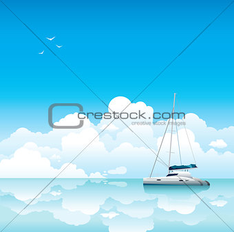 Calm sea with white yacht and clouds