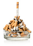 Cigarettes in a glass ashtray