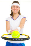 Closeup on ball on racket in hand of female tennis player