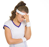 Portrait of concerned female tennis player