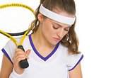 Portrait of concerned female tennis player with racket