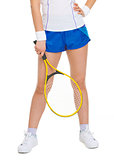 Closeup on racket in hand of tennis player near legs