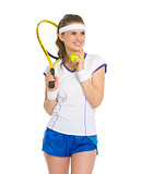 Smiling female tennis player looking on copy space