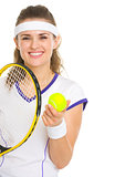 Smiling female tennis player with racket and ball