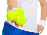 Closeup on female tennis player giving balls
