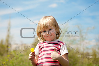 child outdoors in spring