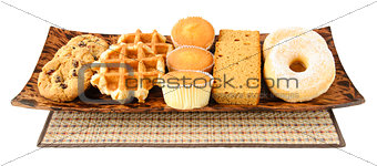 Cakes, cookies, donuts and waffels on the plate