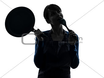 woman cooking holding frying pan thinking silhouette