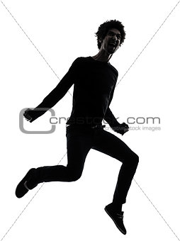 handsome african young man jumping screaming silhouette