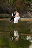 Kissing Female Couple at Lake