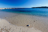 Sunny Beach and Breakwater in Antibes on French Riviera, France