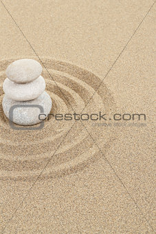 balance zen stone in sand with circles
