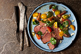 Grilled steak with tomato salad