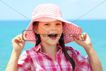 cheerful girl in a hat