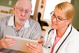 Doctor or Nurse Talking to Senior Man with Touch Pad