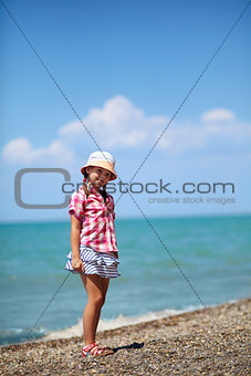 Girl on the pebble beach