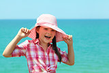 girl in a hat laughing