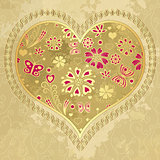 Old grunge paper with gold heart