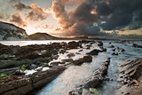 Sunrise ocean landscape Mupe Bay Jurassic Coast England