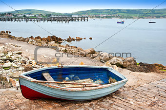 Old rowing boat on launch slipway of seaside town