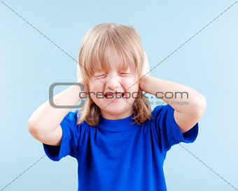 boy covering his ears