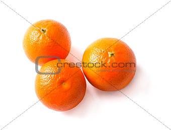 three ripe tangerine on a white background.