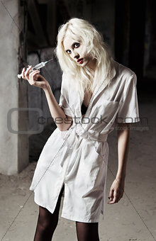 Beautiful young girl in the image of strange mad nurse