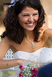 Happy young bride laughing