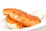 Fried salmon fillets with sauce