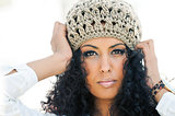 Beautiful black woman wearing wool hat