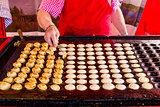 "freshly baked traditional Dutch mini pancakes called ""poffertjes"