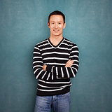 Asian Man In Striped Pullover