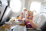 girl eating in the airplane