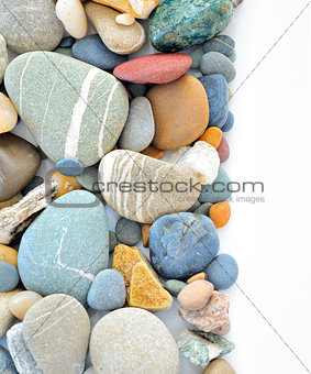 colored stones on white background