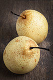 two asian pears on old wooden table