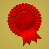 Red award ribbon rosette on gold background