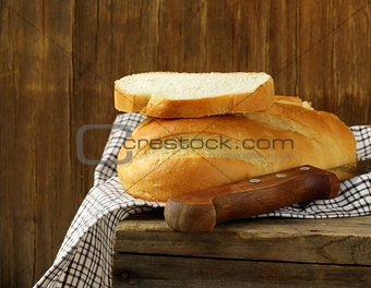 loaf of white bread on a wooden table