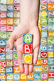 Hand holding abc letters  