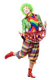 Happy posing female clown