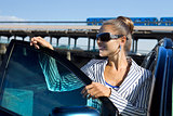 woman in sunglasses near the car